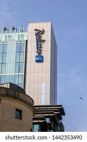 Bristol, UK - June 29th 2019: The Radisson Blu company logo on the exterior of their hotel in the city of Bristol in England.