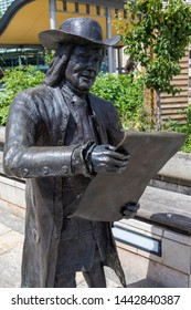 Bristol, UK - June 30th 2019: Statue of English nobleman, writer and Quaker William Penn, on Millennium Square in Bristol. Penn was founder of the English colony the Province of Pennsylvania.