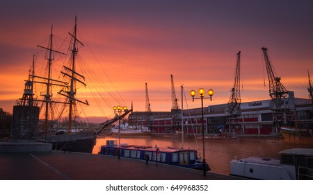 Bristol, UK - March 13, 2016: People enjoying sunset in the evening in Harbourside, Bristol.