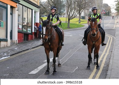 Bristol, UK - March 17, 2011: Horse mounted police officers patrol a city centre street.