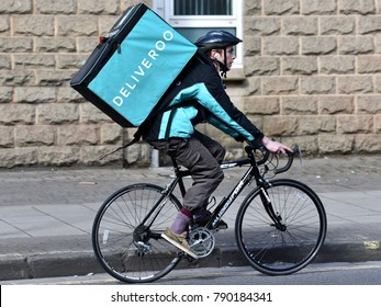 Bristol, UK - March 6, 2015:  A Deliveroo cycle courier rides on a city centre street.