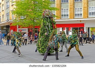 BRISTOL, UK - MAY 6, 2017: Jack in the Green and his attendants parade through the city streets to celebrate May Day. This seemingly pagan ceremony in fact originated in the early modern period.