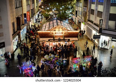 Bristol, UK - November 7, 2014: Crowds of people visit Broadmead during the Christmas holiday shopping season. Broadmead is the city's principal shopping district.