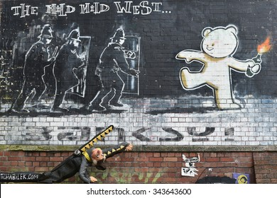 BRISTOL, UK - Oct 31: The acclaimed Banksy graffiti piece titled Mild Mild West on a brick wall in the city centre on Oct 31, 2015 in Bristol, UK. Bristol is well known for its graffiti and street art.