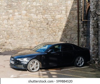 BRISTOL, UNITED KINGDOM - MAR 7, 2017: Elevated view of luxury Audi A7 limousine in a closed parking surrunded by stone wall