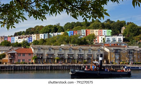 Bristol / United Kingdom - Sept 02 2017: Tourists in a Boat, Harbourside River, Colorful Houses