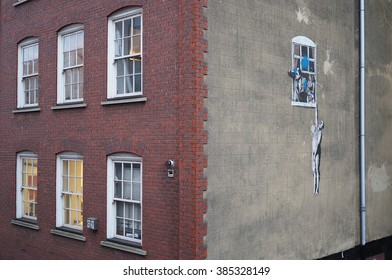 Bristol,UK-February 25,2016: graffiti of the street artist Banksy called 'Naked man' on 25 february 2016. Banksy is an internationally acclaimed artist from Bristol.