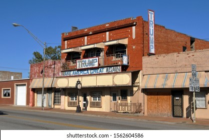 Bristow, OK, USA - Oct. 8, 2019: An old brick building along Route 66 in Bristow, Oklahoma sports signs supporting American President Donald Trump and his Make America Great Again slogan.