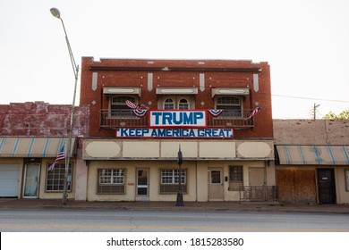 "Bristow, Oklahoma - September 5 2020: A makeshift Donald Trump advertisement for the 2020 election, on an empty brick building in a rural town, saying ""Make America Great Again."""