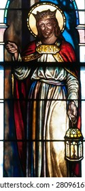 BRISTOW, VIRGINIA - APRIL 26, 2015: Stained glass window of Jesus Christ as Christ the King carrying a lantern and knocking on a door, located in chapel of St. Benedict Monastery