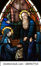 BRISTOW, VIRGINIA - APRIL 26, 2015: Stained glass window of Saint Benedict and his twin sister, St. Scholastica, located in chapel of St. Benedict Monastery