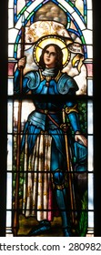 BRISTOW, VIRGINIA - APRIL 26, 2015: Stained glass window of St. Joan of Arc, patroness of France, located in chapel of St. Benedict Monastery