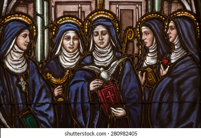 BRISTOW, VIRGINIA - APRIL 26, 2015: Stained glass window depicting five Benedictine female saints, Saints Hildegard, Walburga, Scholastica, Mechtild, and Gertrude, located at St. Benedict Monastery