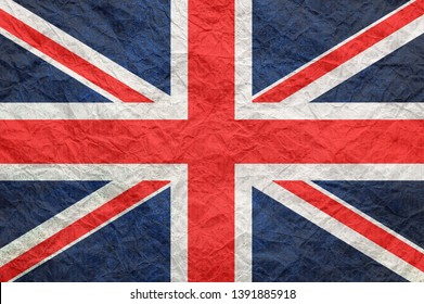 Britain flag on old crumpled craft paper. Textured background wallpaper for design.