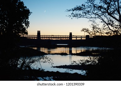 Britannia bridge and Menai Strait with crescent moon as sun sets