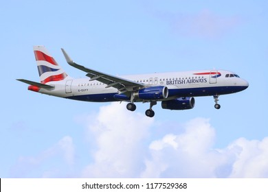 British Airways Airbus A320-232(WL), landing in Amsterdam Schiphol Airport.  Reg: G-EUYY, msn 6290, V2500 jet engines, seat configuration 168 economy class. Amsterdam, Netherlands - August 30, 2018