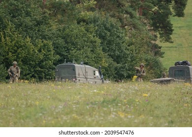 British army Land Rover Defender Wolf truck utility medium military vehicle with infantry soldiers on exercise, Salisbury Plain UK