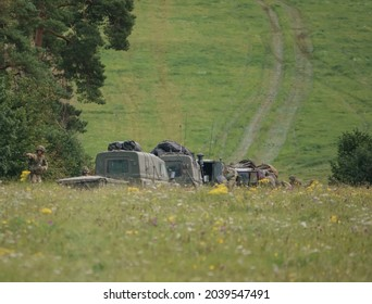 British army Land Rover Defender Wolf military light utility vehicle with infantry soldiers on exercise, Salisbury Plain UK