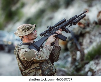 British Army sniper during the military operation in the mountain. war, army, technology and people concept.