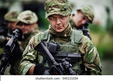 British Army sniper during the military operation in the city. war, army, technology and people concept.