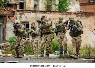 British Army sniper team during the military operation in the city. war, army, technology and people concept.