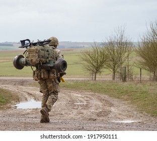 British army soldier completing an 8 mile tabbing exercise with fully loaded 25Kg bergen