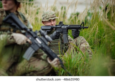 British Army soldier during the military operation in the forest. war, army, technology and people concept.