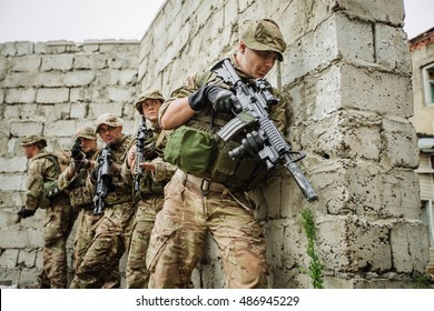 British Army soldier during the military operation in the city. war, army, technology and people concept.