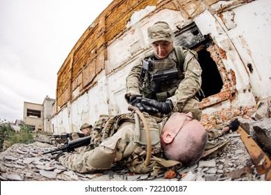 British Army soldier during rescue operation in the city. war, army, technology and people concept.