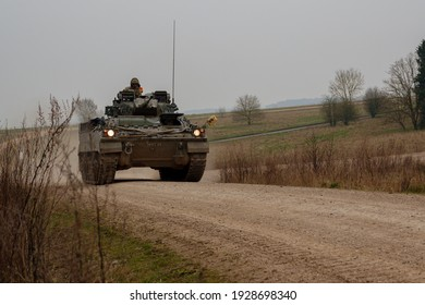 British army Warrior FV510 light infantry fighting vehicle tank in action on military exercise, Salisbury Plain, Wiltshire UK
