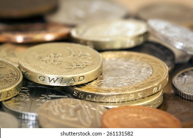 British coins in full frame background.  Shallow focus.