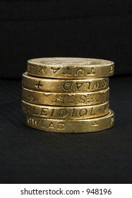 british coins over a black background