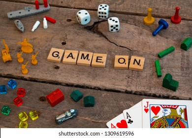 """British Columbia, Canada, - February 01, 2019 - """"Game On"""" made from Scrabble game letters, Risk, Battleship pieces, Monopoly, Settler of Catan and other game pieces - Image"""