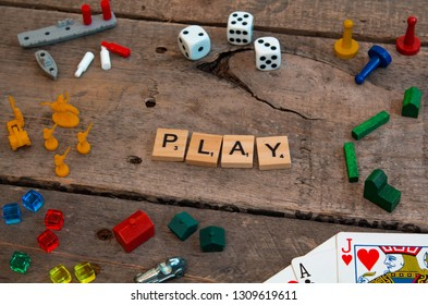 """British Columbia, Canada, - February 01, 2019 - """"Play"""" made from Scrabble game letters, Risk, Battleship pieces, Monopoly, Settler of Catan and other game pieces - Image"""