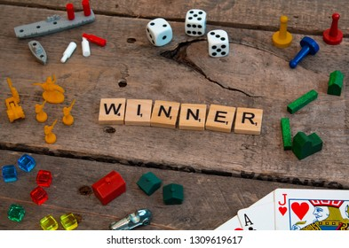 "British Columbia, Canada, - February 01, 2019 - ""Winner"" made from Scrabble game letters, Risk, Battleship pieces, Monopoly, Settler of Catan and other game pieces - Image"