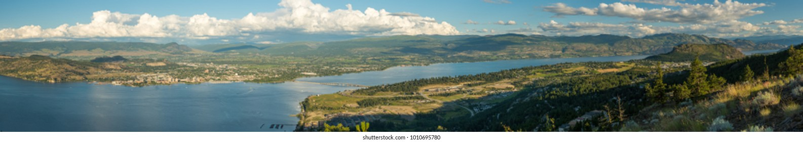 British Columbia, Canada.  Panoramic view of the city of Kelowna, and Okanagan Lake and Valley in summer as viewed from West Kelowna.