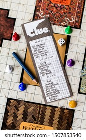 BRITISH COLUMBIA, CANADA - SEPTEMBER 14, 2019: Clue 1972 (Second Edition) - The board with checklist, tokens, die, pencil, cards and checklist all ready to play the game