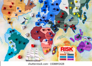 BRITISH COLUMBIA, CANADA - SEPTEMBER 14, 2019: 1975 Risk board game - With cards, dice, and tokens