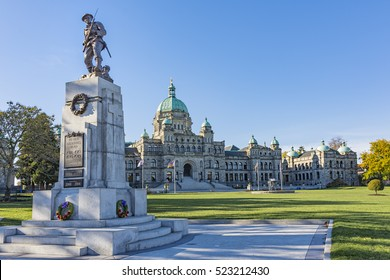 British Columbia Parliament Building with War Memorial in the foreground  on a sunny day Victoria BC Canada