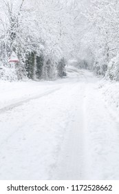 British country lane in rural countryside covered in snow in winter. Buckinghamshire, UK