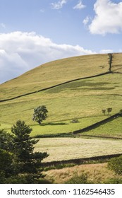 British countryside scene of hills and blue sky in Edale Valley, the Peak District, UK