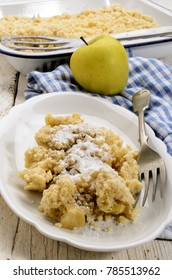 british crumble cake with powdered sugar on a plate