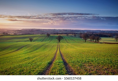 British farming fields in sunrise light at spring in Much Wenlock, Shropshire, UK