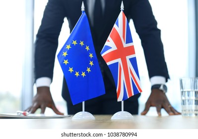 British flag and flag of European Union with businessman near by. Brexit.