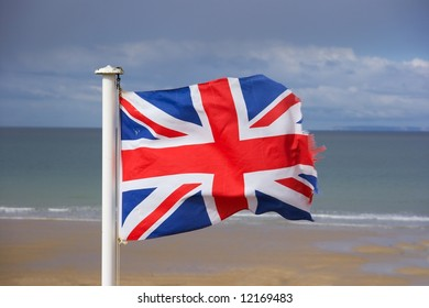 British flag fluttering in the wind on the shore