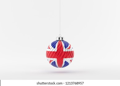 British flag on a glossy christmas ball hanging on a string on white background