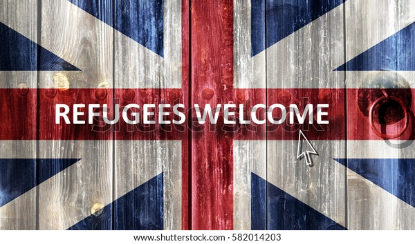 British flag painted on an old wooden door. Next to the door handle text Refugees Welcome