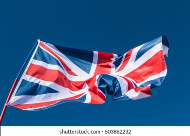 british Flag in the wind on blue sky