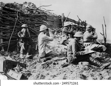 British and French artillery observers during World War 1. Soldiers use binoculars and one is on a field telephone to communicate with artillery. Ca. 1914-18.