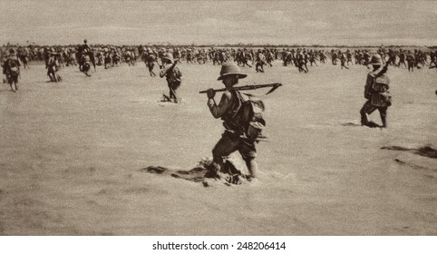 British invaders advancing through flooded Mesopotamia in 1916. They met strong Turkish resistance, but finally entered Baghdad on March 17, 1917.